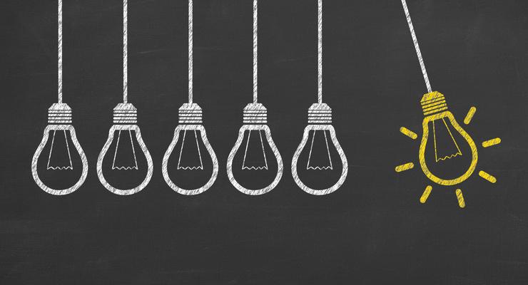 Idea Light Bulb Conceptual Work on Blackboard